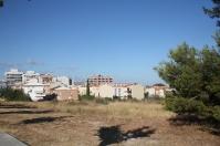 Terreny de la Masia d'en Dimes amb vistes al barri del Molí de Vent